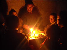 Gazan family eating by candlelight, 17.11.08