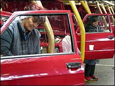 Workers at a Yugo factory in central Serbia