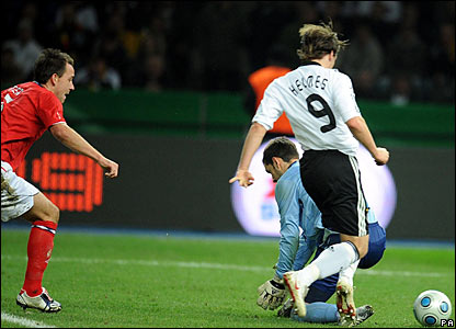 "Germany""s Patrick Helmes scores after a mistake by Scott Carson and John Terry"