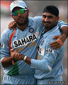 Yuvraj Singh and Harbhajan Singh celebrate an England wicket