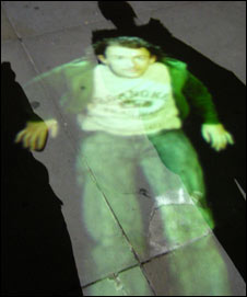 An image of a portrait projected on a shadow