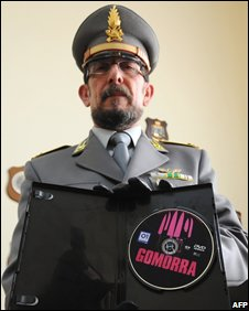 An Italian policeman displays a pirated copy of Gomorra in Naples on 20 November