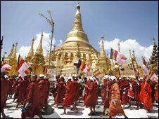 Buddhist monks march down a street in protest in Yangon on 25 September 2007