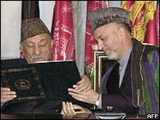 Hamid Karzai [R] with former king Zahir Shah