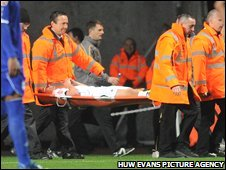 Swans midfielder Ferrie Bodde is stretchered off against Birmingham