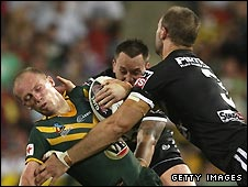 Darren Lockyer (left) is tackled during the World Cup final