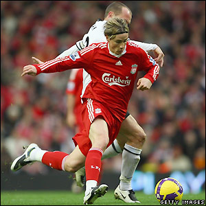 Liverpool's Torres heads for goal