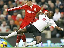 Fernando Torres is challenged by Fulham's John Pantsil