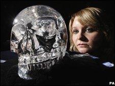 woman viewing skull of doom