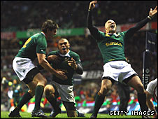 South Africa players celebrate after Bryan Habana (centre)