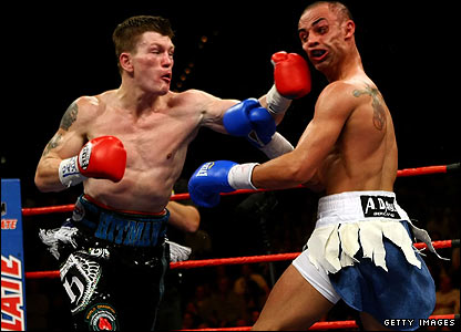 Ricky Hatton lands a punch on Paulie Malignaggi