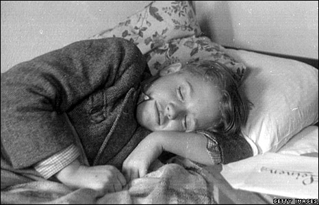 A refugee child rests at Dovercourt Bay holiday camp