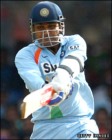 Virender Sehwag smashes a six in Bangalore