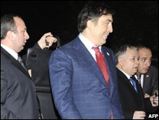 Mikhail Saakashvili (second from left) and Lech Kaczyinski (second from right) flanked by bodyguards near the breakaway province of South Ossetia, Georgia, 23 November 2008