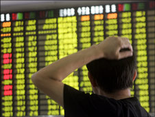 An investor looks at trading board in a private Shanghai company Sep 2008.