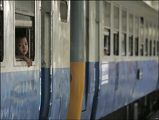 A child looks out window of a Thai train, 2008.