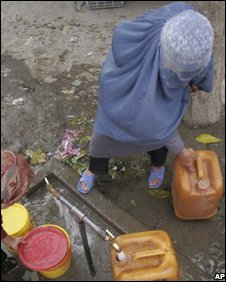 Woman collects water