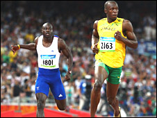 Tyrone Edgar (left) and Usain Bolt in the Olympic 100m semi-finals