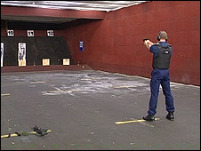 A police firearms officer training with a Glock self-loading pistol