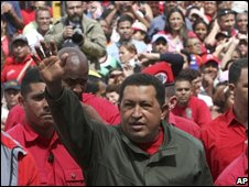 President Chavez waves to supporters during Sunday's election
