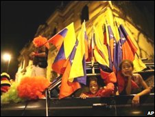 Young supporters of Hugo Chavez peer from a car after election results were announced in Caracas, Venezuela, 23 November 2008