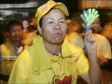 Yellow-clad protesters enter Bangkok's old airport building, 25 Nov 2008.