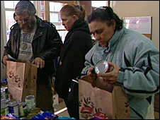 People collect handouts at the Jonnycake Center