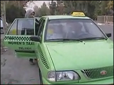 A customer boards a Women's Taxi in Tehran