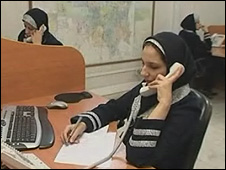 An operator takes a call at the call centre in Tehran