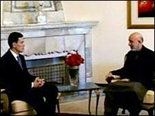 David Miliband and Hamed Karzai