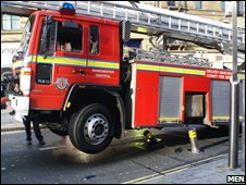 Fire engine being lifted of the street bollards