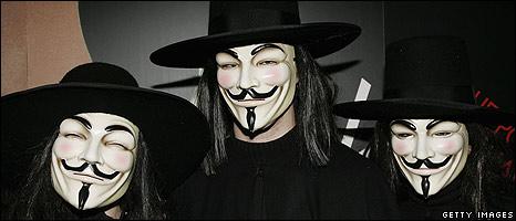 Men wearing Guy Fawkes masks