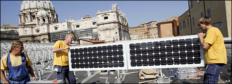 Workman placing solar panels on the Vatican roof