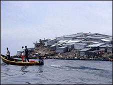 A boat by one of the Migingo islands on Lake Victoria