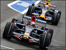 Sebastian Vettel of Toro Rosso leads Mark Webber of Red Bull in Belgium