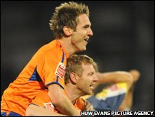 Reading goal-scorers Kevin Doyle (top) and Brynjar Gunnarsson