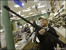 A man holds a .50 caliber rifle at a gun shop in Fort Worth, Texas (06/11/2008)