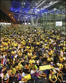 Anti-government protesters sit in front of the departure terminal at Suvarnabhumi airport, Bangkok