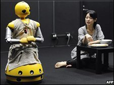 Actress Minako Inoue rehearses with her robot cast mate