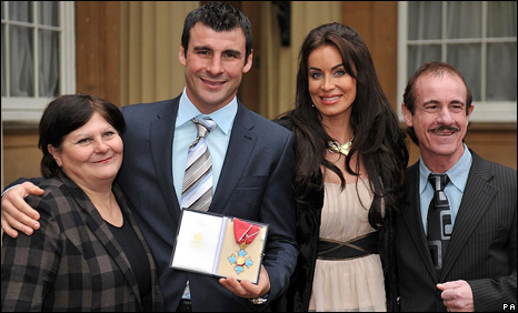 Joe Calzaghe outside Buckingham Palace with mother Jackie (left), girlfriend Jo-Emma and father Enzo