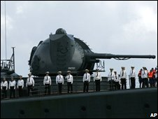 Russian sailors line up on the deck of their ship as they arrive in Venezuela