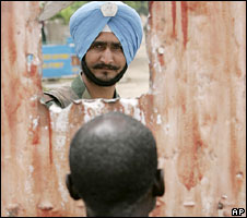 An Indian United Nations soldier looks on at a makeshift camp for displaced persons in DR Congo