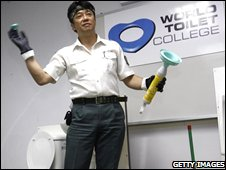 Japanese �Toilet professor� Atsuhiro Katsumata talks to a class of toilet cleaners in Singapore (file photo)