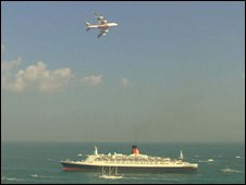 An Airbus A380 superjumbo flypast met the QE2 when she arrived in Dubai