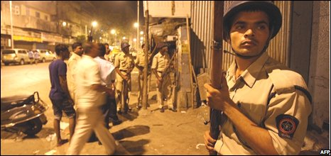 Police outide the train station attacked in Mumbai
