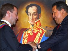 Dmitry Medvedev (L) and Hugo Chavez in front of a portrait of Venezuela's independence hero Simon Bolivar