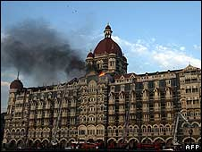 Flames and black smoke billow from the Taj Mahal Palace hotel, Mumbai