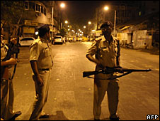 Indian policemen cordon off the site of an attack in the Colaba area of Mumbai
