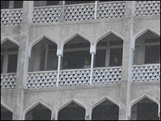 People on the balcony of the Taj Towers