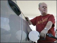 Customers refuels his car